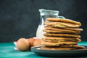 Pancakes stack pile and fresh ingredients